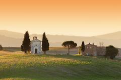 Tuscany landscape at sunrise with a little chapel of Madonna di Vitaleta, San - stock photo