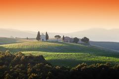 Tuscany landscape at sunrise with a little chapel of Madonna di Vitaleta, San Stock Photos