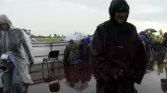 Stock Video Footage of Media escaping heavy rain during 55th anniversary event of the Frecce Tricolori