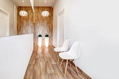 Modern waiting room, reception. Cozy minimalistic interior - stock photo