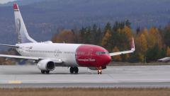 Airplane NAX Norwegian Boeing 737 taxiing ambient audio Stock Footage