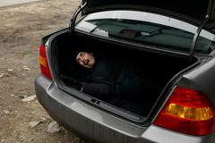 Man in the trunk Stock Photos