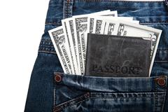 money with a passport in your pocket - stock photo