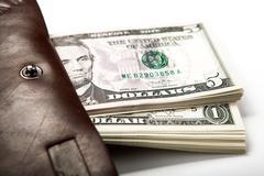 spending money in your wallet - stock photo
