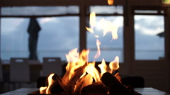 Fireplace on a table at a beachclub - Medium Stock Footage