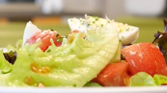 Healthy food summer salad of fresh vegetables in restaurant - body care food Stock Footage