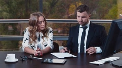 Young woman signs documents in the office Stock Footage