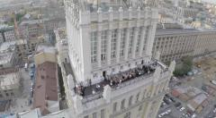 Stock Video Footage of aerial celebration on the roof of the tower in Moscow by drone