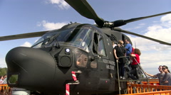 People visit army helicopter in Rivolto, Italy Stock Footage