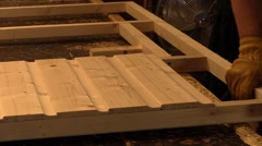 Carpentry . Assembling wood . Making a panel - stock footage
