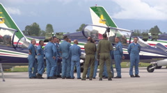 Mechanics chat beside Frecce Tricolori planes Stock Footage