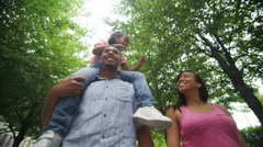 4K Happy African American family walking in urban park Stock Footage