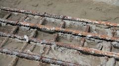 Water drops on armed concrete rusty metal SloMo Stock Footage