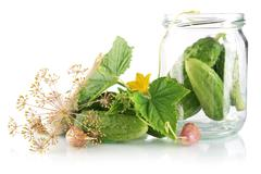 Ingredients for pickling or preserves cucumbers with flower bud,leaves,jar,ga Stock Photos