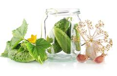 Ingredients for pickled or preserved cucumbers with flower bud,leaves,jar,gar Stock Photos
