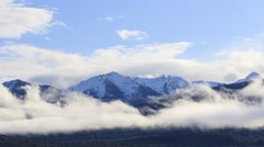 Time lapse clouds moving against snow mountain te anau lake new zealand Stock Footage
