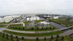 Drone aerial bird view industrial area harbor showing oil storage tanks ships 4k Stock Footage