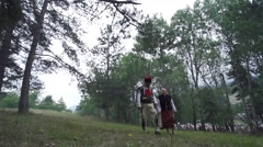 Man and woman walking on the meadow dressed in ancient costumes Bulgarian Stock Footage