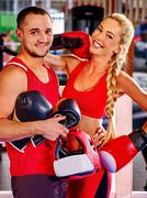 Stock Photo of Female boxer with your male coach after workout