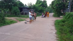 Thai Buddhist Monks collect alms. Stock Footage