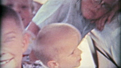 1961: Packing 4 kids into the back of a car for a family road trip. Stock Footage