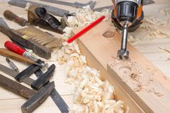 Carpentry tools and wood shavings in the workshop Stock Photos