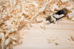 jointer and softwood shavings on boards - stock photo