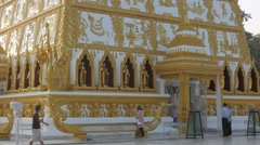 People praying around Nong Bua temple,Ubon Ratchathani,Thailand Stock Footage