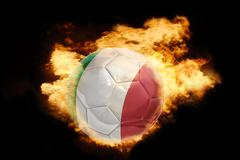 football ball with the flag of italy on fire - stock photo