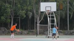 Thai boys practising basketball,Ubon Ratchathani,Thailand Stock Footage