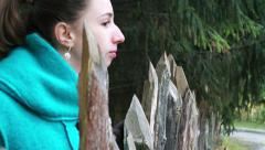 Wooden palisade in forest and girl. Stock Footage