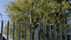 Barbed fence, razor around the detention camp Vysni Lhoty Stock Footage