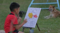 Thai boy colorizing in playground,Ubon Ratchathani,Thailand Stock Footage