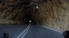 Biker going throught road tunnel, time-lapse 4 times Stock Footage
