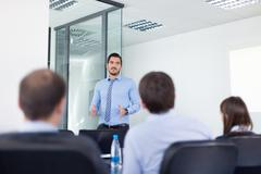 Business man making presentation in office on job interview. - stock photo