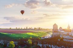 Castle in Kamianets Podilskyi and air balloon - stock photo
