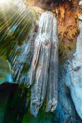 Cave stalactites and stalagmites - stock photo