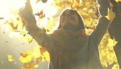 Woman throwing golden leaves in autumn park, slow motion, shot at 240fps Stock Footage