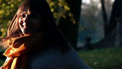 Happy excited woman turning round in autumn park, super slow motion Stock Footage