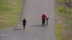 People walking on pathway near shoreline in Varberg viewed from a high angle. Stock Footage