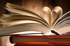 Hardcover book with two pages formed in the shape of heart. Stock Photos