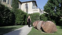 Woman Exterior Chateau Walks to Wine Jugs Stock Footage