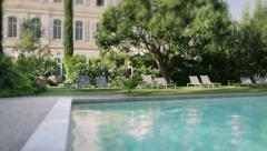 Poolside at the Mansion Woman Exit Wide Stock Footage