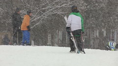 People at ski resort in Ontario in snowstorm and blizzard Stock Footage