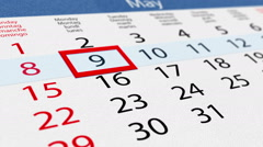 Pasteboard calendar with moving pointer Stock Footage