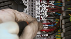 Electrician repairing a fuse box Stock Footage
