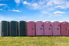 Outdoor Portable Toilets on an Open Field - stock photo