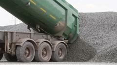 Dumper truck delivering gravel for asphalt plant Stock Footage