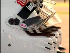 Indy Car racing helmets - rack focus Stock Footage