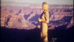 2644 - tourists relax at rim of the Grand Canyon - vintage film home movie Stock Footage